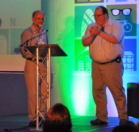 Photo of Nigel Bevans and Chris Hass on a stage