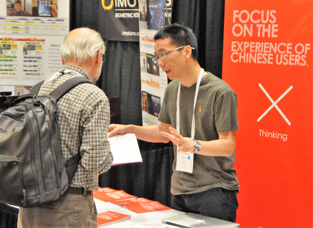 Photo of Nigel Bevans visiting a conference booth