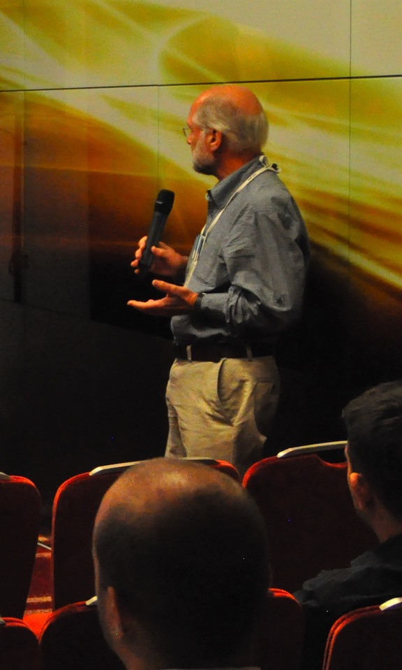 Photo of Nigel speaking to an audience.