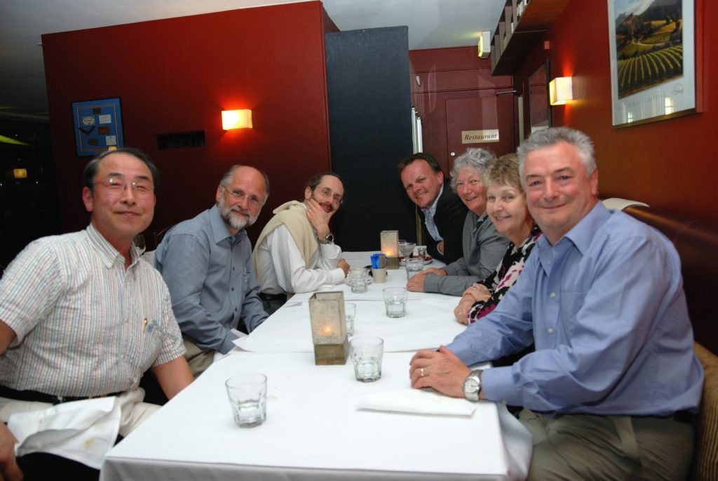 Group photo of Nigel with colleagues after a meal.