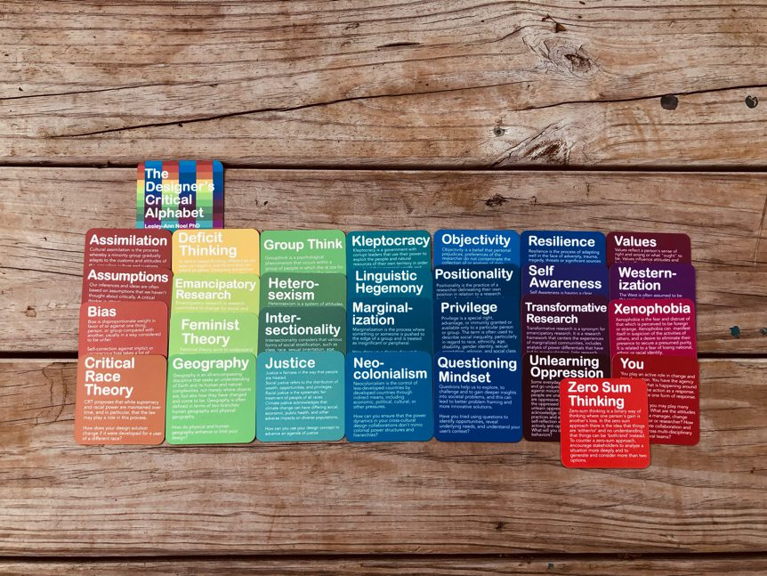 A photo of colorful cards with descriptions such as assimilation, zero-sum thinking, and so on.